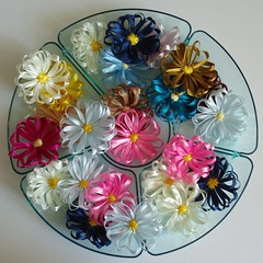 Hand made ribbon flower brooches by Jane Cameron
