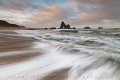 End of Times (Jim Patterson Photography) Tags: california morning usa seascape blur color beach nature clouds sunrise landscape dawn coast rocks surf waves arch natural cove secret shoreline rocky coastal shore conspiracy rugged seastack jimpattersonphotography jimpattersonphotographycom seatosummitworkshops seatosummitworkshopscom