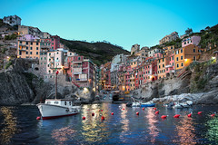 Riomaggiore At Dusk - (Cinque Terre, Italy) (blame_the_monkey) Tags: travel italy reflection history water architecture photoshop photo nikon italia dusk tripod wideangle pic architectural historic reflect blended handheld nik cinqueterre bluehour digitalphoto dri riomaggiore blend topaz photoshopeffect postprocessing travelphotography 5terre dynamicrangeincrease 2470 travelphoto digitalblending wetreflection niksoftware d700 topazadjust blamethemonkey elilocardi elialocardi