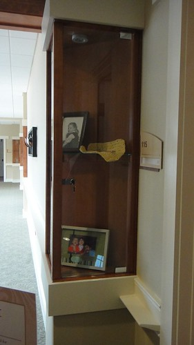 Memory boxes displaying personal memorabilia are located outside of each resident suite to help residents locate their rooms if they forget their room numbers.