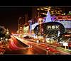 the city with its glitz and glamour.. (PNike (Prashanth Naik)) Tags: road longexposure red sky streets cars colors night thailand trafficlight nikon streetlight asia traffic bangkok vibrant citylights lighttrails bling citynight highrisebuildings d3000 mbkmall glitzandglamour pnike