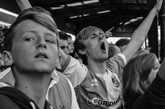 Chanting despite defeat. Bristol Rovers v Mansfield Town football (sophie_merlo) Tags: street bw news blancoynegro sports sport bristol football noir noiretblanc candid negro streetphotography photojournalism documentary nb bn relegation mansfieldtown bristolrovers