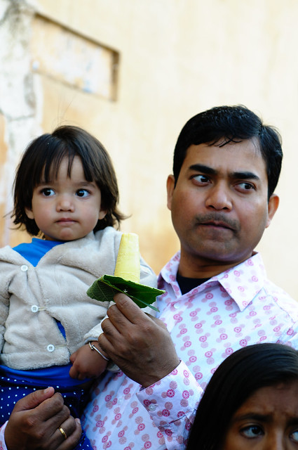Man and Child eating kulfi