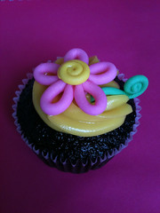 FLEUR! (Xquisite cakes) Tags: pink brown flower green yellow yummy pretty chocolate delicious cupcake icing embossed frosting chocolatecupcake cuppy sugarpaste cuppie flowerpaste shimmerdust