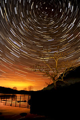 Crummock Water Startrails (Nick Landells) Tags: nightphotography sunset lake tree night stars star warm glow nightshot sundown lakedistrict cumbria ashtree lakeland meteor crummockwater meteorite startrails polaris shootingstar polestar