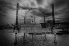 The Eye is Rigged (TheFella) Tags: uk greatbritain england blackandwhite bw white black slr london eye water monochrome westminster thames clouds digital canon river eos photo high europe dynamic unitedkingdom south capital pipes platform bank overcast londoneye southbank photograph rig processing gb dslr range riverthames whitehall hdr highdynamicrange embankment countyhall drilling postprocessing 500d photomatix