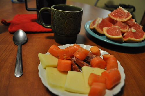 Carrots, salami, swiss cheese, grapefruit, and coffee..meal by water your plants