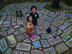 Two Rather Forced Smiles (spinadelic) Tags: family 2 two portrait rock kids children chalk milk backyard little sister brother stones duo pair smiles siblings april boxes arkansas forced crate stevespencer 2011