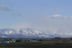 View from the expressway (Beckywithasmile) Tags: blue sky snow mountains japan march hokkaido bluesky 北海道 日本 山 雪 空 家 obihiro 曇り 帯広 運転 田 青い 青い空 beckywithasmile march2011 japan2011