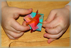 5 Intersecting Squares in Hands of My Son (Aneta_a) Tags: square hands origami child planar modularorigami simplepaper