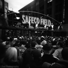 [4-8-2011] - Take Me Out To The Ball Game (J.Sod) Tags: seattle film holga lomo baseball crowd toycamera lofi delta mariners safeco safecofield fans 365 holga120 ilford ilforddelta400 emeraldcity openingday masses seattlemariners sportsfans mlb blackandwhitephotography jetcity raincity filmphotography majorleaguebaseball newseason takemeouttotheballgame ilforddelta ilforddelta400pro nationalpasttime project365 marinersfans photographysquared safecofieldleftentrance