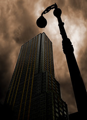Leave the light on for me... (gimmeocean) Tags: newyorkcity ny newyork night cloudy manhattan midtown stormclouds 6thave iphone avenueoftheamericas cloudynight iphoneography