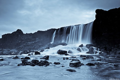xarrfoss waterfall - ingvellir National Park, Iceland (skarpi - www.skarpi.is) Tags: park longexposure travel winter red sky lake reflection ice water rock river flow frozen waterfall iceland nationalpark frost time north smooth arctic ontherocks redsky wonderland foss valhalla ingvellir sland frozenintime fossar s xar xarrfoss rokcs klaki frostings icelandicwaterfall jgarur slenskirfossar deepnorth thingvalla jgarurinn travelingiceland