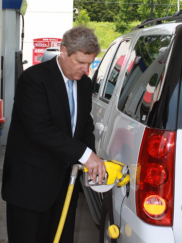 Agriculture Secretary Tom Vilsack pumps gas after speaking about the benefits of Ethanol E-85 at a gas station in Nashville, TN, on Monday, May 23, 2011.