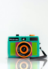 Hello Holga (aka Mystery Machine) (Brandon Christopher Warren) Tags: orange green photoshop 35mm lens mirror holga cyan magenta raleigh 50mm14 strap product asheboro productshots productlighting gretchenbleiler simplelighting peacecamera matboards brandonwarren simplesetup eos5dmarkii