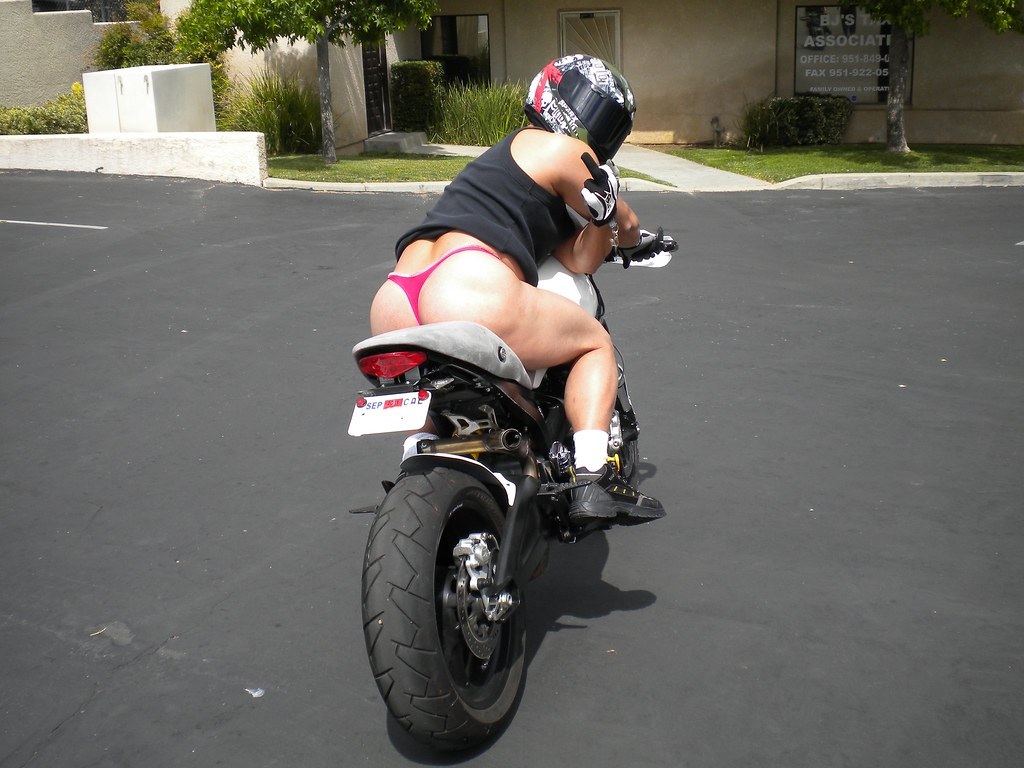 Thong girls on back of motorcycle