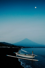 Bali (EdBob) Tags: ocean morning blue sea sky bali moon mountain beach water indonesia asian dawn volcano coast asia traditional indianocean bat shoreline canoe east shore sail coastline gunung fishingboat balinese outrigger agung amed blacksandbeach activevolcano gunungagung jukung mtagung edmundlowe edlowe edmundlowe allmyphotographsarecopyrightedandallrightsreservednoneofthesephotosmaybereproducedandorusedinanyformofpublicationprintortheinternetwithoutmywrittenpermission edmundlowephotography edmundlowestudiosinc