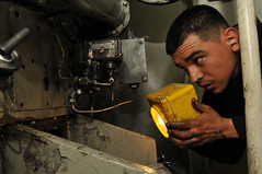 Enginemen 2nd Class, Justin Davila inspects service diesel aboard the USS Boone (Official U.S. Navy Imagery) Tags: navy sailor usnavy guidedmissilefrigate ussbooneffg28 deckdepartmentsailors southernseas2011
