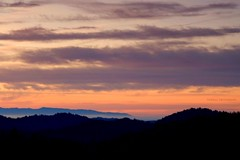 Happy Easter (Swiv) Tags: california morning pink trees orange usa black clouds sunrise colours purple silhouettes hills