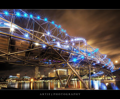 The Helix Bridge in Marina Bay, Singapore :: HDR (Artie | Photography :: I'm a lazy boy :)) Tags: bridge reflection building art architecture modern night photoshop canon landscape lights landscapes singapore skyscrapers tripod pedestrian wideangle symmetry helix ef 1740mm hdr artie cs3 marinabay 3xp f4l photomatix tonemapping helixbridge tonemap 5dmarkii 5dm2
