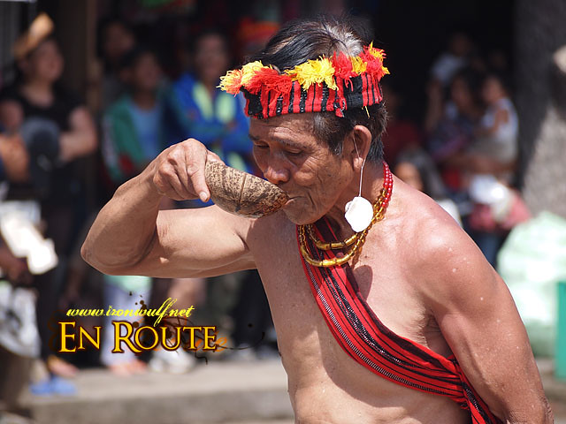 An elder drink Rice Wine during the performance