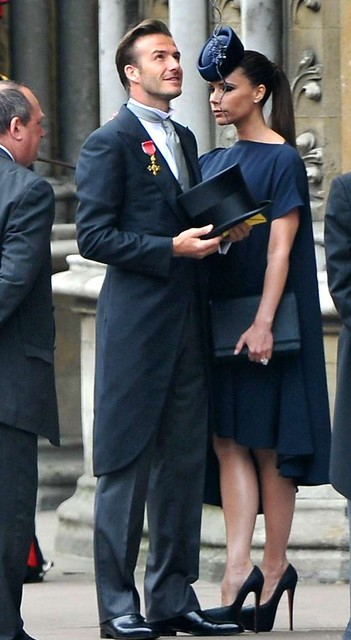 Victoria-and-David-Beckham-Attend-The-Royal-Wedding-561x1024