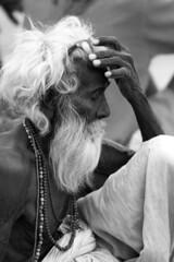 Sadhu, Varanasi (charliedotgilbert) Tags: old blackandwhite india man glasses indian longhair bored sombre tired varanasi hindu sadhu ghats benares ghat uttarpradesh saddu gangaghats