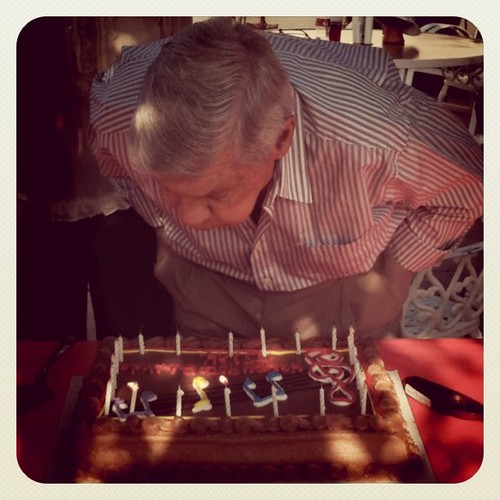 Grandpa blowing out his candles.