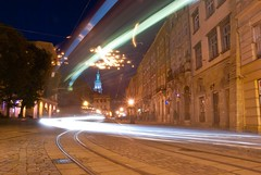 tram on Rynok Square (Kuba Abramowicz) Tags: world street old city travel light color colour heritage colors architecture night square outdoors lights site movement nikon scenery europe long exposure track cityscape market main scenic tracks tram lviv ukraine unesco east eastern buldings bulding rynok d80 euro2012 ploshcha lptracks