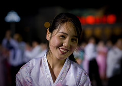 DANSEUSE AU BAL DU 15 AVRIL A PYONGYANG, COREE DU NORD (Eric Lafforgue Photography) Tags: voyage travel portrait woman color colour cute sexy girl smile face smiling horizontal night happy dance asia dancers dress robe feminine femme smiles nightlight hanbok asie jolie soiree custom 2008 nuit fille sourire couleur oneperson northkorea visage ideology axisofevil pyongyang eastasia feminin dprk toothysmile traditionalclothing arirang juche lookingatcamera coleur northkorean festivites seduisante oneyoungwomanonly dictature democraticpeoplesrepublicofkorea northkoreans koreanpeninsula unepersonne juchesocialistrepublic coreedunord rdpc koreanethnicity insidenorthkorea lumiereartificielle eclairagedenuit joseonot
