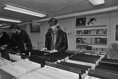 Difficult to choose (cotnari73) Tags: lp shop teenager teen music vinyl analogue analog sandviken sweden nikonf4 nikkor24mm fomapan400 developed d7611 epson explore