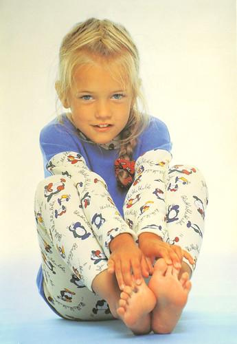 Little Barefoot Girl Shows Her Feet Soles 2