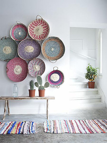 woven baskets as wall art