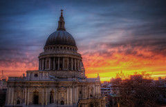 St Paul's Sunset (TheFella) Tags: uk greatbritain sunset red england sky sun building slr london church yellow architecture clouds digital photoshop canon eos gold photo high europe purple dynamic cathedral unitedkingdom capital columns stpauls thecity pauls spire photograph dome processing gb wren dslr stpaulscathedral pillars range renaissance hdr highdynamicrange anglican cityoflondon portlandstone postprocessing 500d sirchristopherwren photomatix englishbaroque cathedralchurchofpaultheapostle