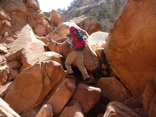 Ilana scrambles over rocks
