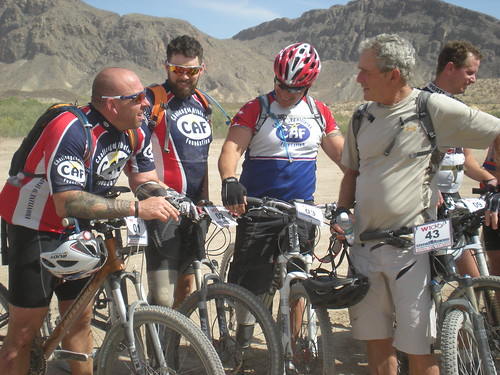 President Bush talks with some warriors after the ride on Day One