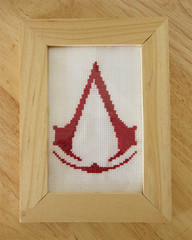 assassin's cross stitch (the toki cafe) Tags: crossstitch embroidery videogames geekery assassinscreed assassinlogo