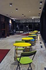 Loeb Lobby (AntyDiluvian) Tags: cambridge green art yellow night theater chairs massachusetts harvard lobby harvardsquare tables bostonist loeb brattlestreet loebdramacenter americanrepertorytheater
