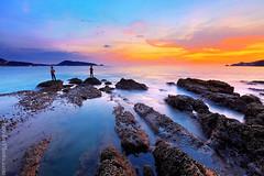 Kalim Beach Sunset  - thailand (A.alFoudry) Tags: trip light sunset sea orange cloud color beach rock clouds canon thailand island eos rocks colorful ray mark tide wave full shore frame april 5d kuwait phuket heavy ef similan kuwaiti q8 abdullah newer عبدالله جزيره mark2 2011 1635mm || f28l kuw q80 q8city xnuzha alfoudry الفودري foudryphotocom mark|| 5d|| canoneos5d|| mk|| تايلاند