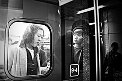 * (A.D.Q.) Tags: boy shadow blackandwhite reflection window girl train canon asian looking metro streetphotography gritty korean seoul commute stare asianboy asiangirl 550d seoulmetro