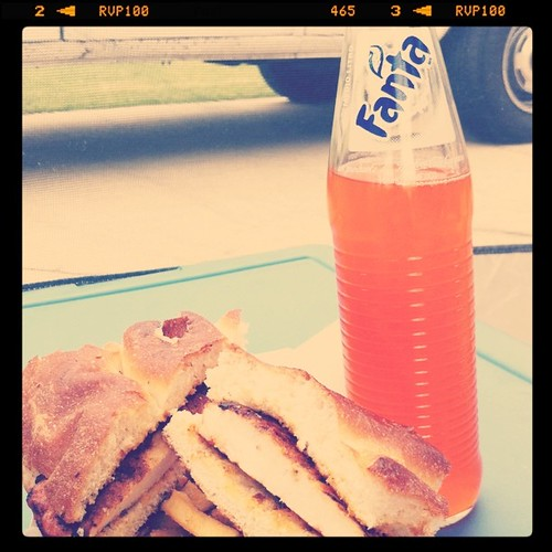 Project 365 169/365: My son's lunch at the farmer's market today. Orange soda in a glass bottle and chicken on ciabatta.