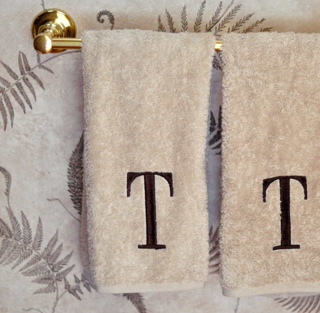 monogrammed T towels in guest bathroom