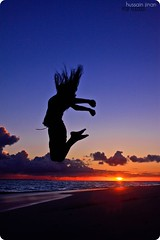 The leap of honor before the dusk! (Prof EuLOGist) Tags: sunset beach girl canon hair island jump action maldives uninhabited atoll jinan hussain 500d dhaalu huvadhoo gaafu
