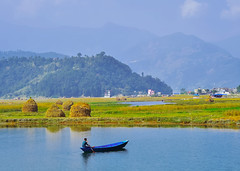 Young man fishing on a lake from the boat (marozn) Tags: art asia background beautiful blue boat boats calm color colorful day fewa group himalaya lake lakeside landscape morning mountain mountains nature nepal outdoor panorama people phewa pokhara skyline spring still summer tourism traditional transport travel view wallpaper water wooden ship boy man men small little grass field forest hay swimmer boating fishing activity freshwater one person