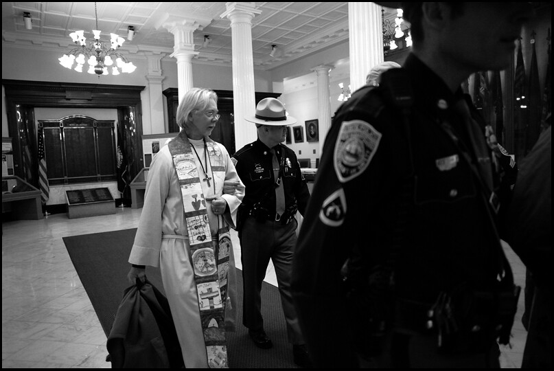 Clergy escorted from State House