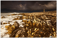 after the storm (chris frick) Tags: light sunset lighthouse seascape storm clouds rocks waves wideangle filter lee sicily drama mediterraneansea sanvitolocapo canonef1635mmf28liiusm chrisfrick canoneos5dmark2 09gndsoft 075gndhard
