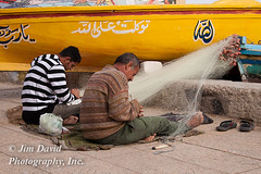 Egyptian Fishermen Repairing Nets (jim_david) Tags: fish man men net senior alexandria boat fishing fisherman mesh stock working egypt commercial repair egyptian repairing buoy restoring fishingnet