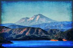 Shasta (Monica's Dad) Tags: california blue mountain lake art montagne photoshopped reservoir snowcapped bergen montaa mountshasta  montagna montanha shastalake fjell bundok da munte  gra    planina  vuori  ni hegyi