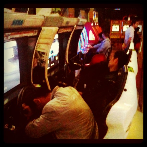 Fieldwork: 3 people asleep in a row at arcade gaming center