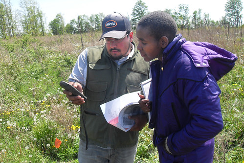 NRCS District Conservationist Edwin Martinez conducts a wetland determination assisted by Earth Team Volunteer Tula Ngasala near St. Johns, Mich. Ngasala, a Tanzanian engineer, assists the St. Johns Field Office one day a week.